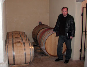 Francis with wine barrels